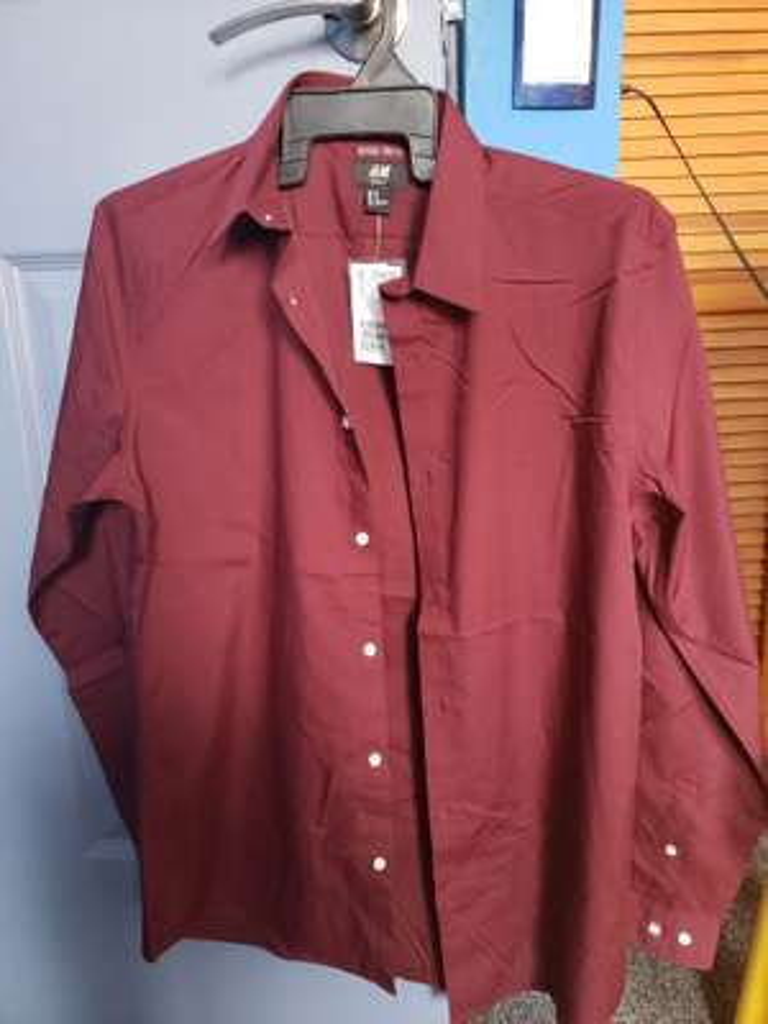 H&M: Camisa $99.5